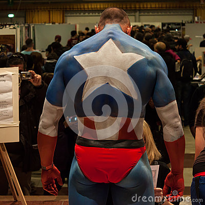 Bodybuilder during a body painting session at Milano Tattoo Convention Editorial Stock Photo