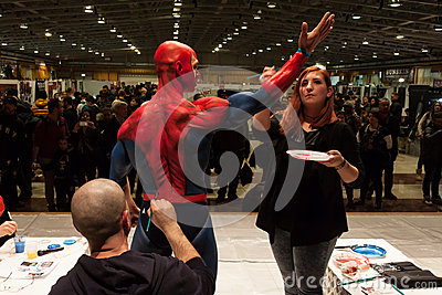 Bodybuilder during a body painting session at Milano Tattoo Convention Editorial Image