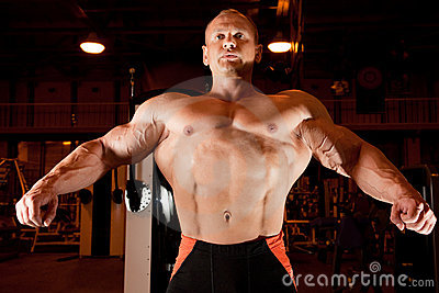 Bodybuilder demonstrates his muscles