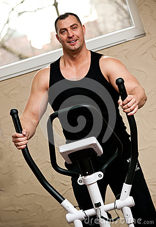 Bodybuilder exercising in gym
