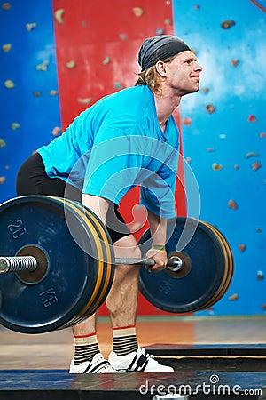 Bodybuilder lifting weight at sport gym