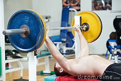 Bodybuilder lifting weight at sport gym