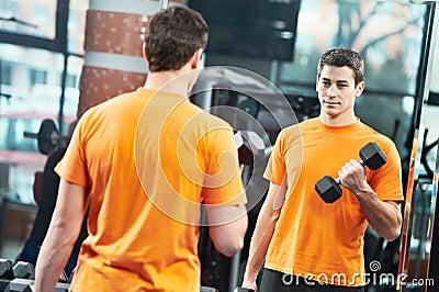 Bodybuilder man doing biceps muscle