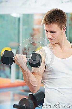 Bodybuilder man doing biceps muscle exercises