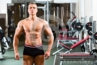 Bodybuilder posing in Gym