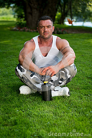 Bodybuilder Resting In Nature
