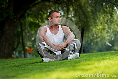 Bodybuilder Resting In Nature