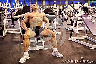 Bodybuilder rests in training room