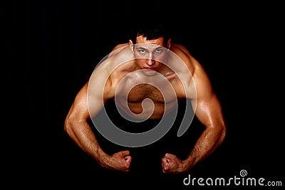 Bodybuilder showing his strength