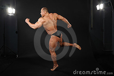 Bodybuilder takes graceful pose of running