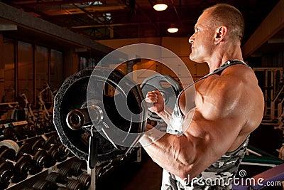 Bodybuilder in training room