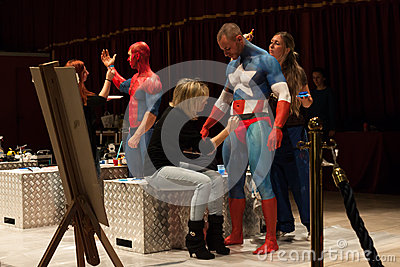 Bodybuilders during a body painting session at Milano Tattoo Convention Editorial Photography