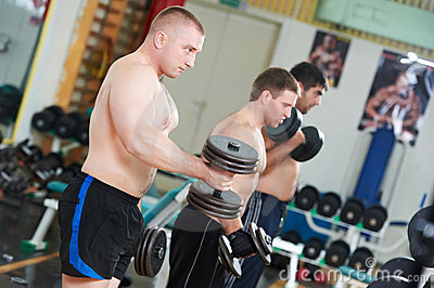 Bodybuilders lifting weight at sport gym