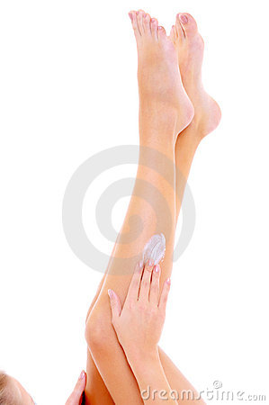 Bodycare of female legs with a cosmetic cream