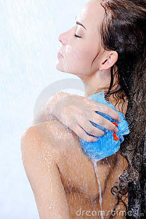 Bodycare by young beautiful woman taking shower