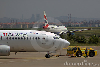 BOEING 737-300 with Tow Truck and AIRBUS A-319 Editorial Photography