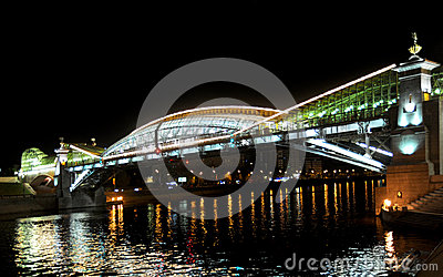 Bogdan Khmelnytsky Bridge (The Kiev foot bridge) through the Moskva River in Moscow at night.