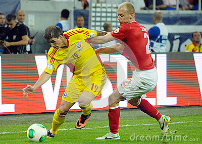 Bogdan Stancu and Semih Kaya in Romania-Turkey World Cup Qualifier Game Editorial Stock Photo