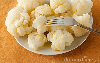 Boiled cauliflower on a plate, served tablecloth