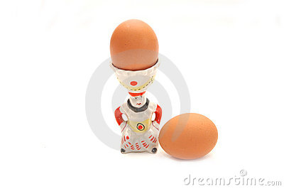 Boiled egg sits in a ceramic egg cup