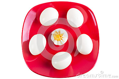 Boiled eggs on red plate