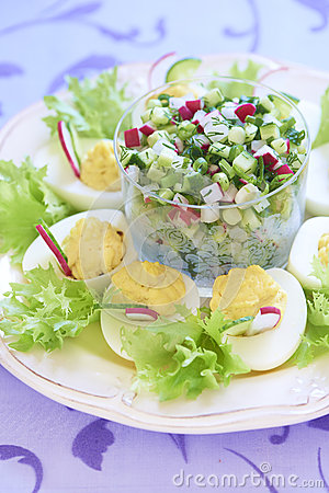 Boiled eggs with salad, cucumber and radish