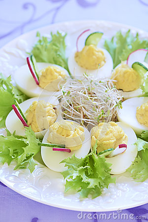 Boiled eggs with salad, sprouts, cucumber and radi