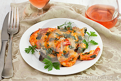 Boiled fish with seafood