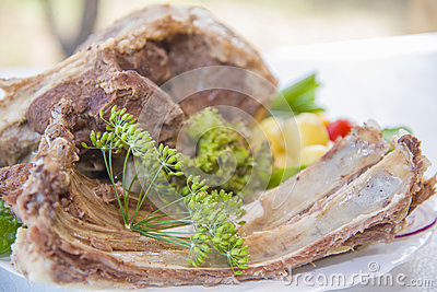 Boiled mutton laid out on a platter with vegetables. Stock Photo