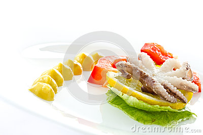 Boiled octopus with lemon slice