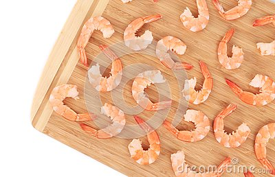 Boiled shrimps on cutting board.