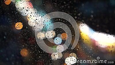 Bokeh através da janela molhada