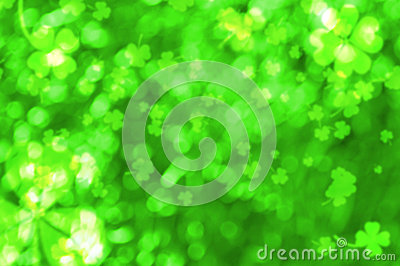 Bokeh effect with blurred clovers. St. Patrick s Day background