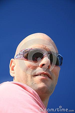 Bold man with sunglasses