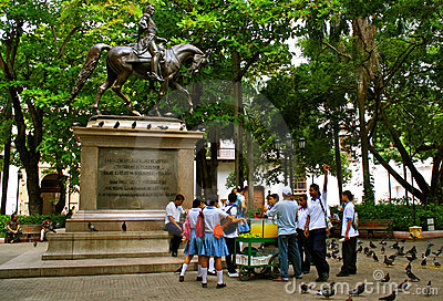 Bolivar Statue with Colombian Students Editorial Photo