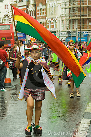 Bolivian flag bearer at the Carnaval del Pueb Editorial Stock Image