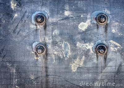 Bolts on a Corroded Metal Surface
