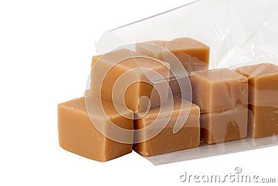 bonbons caramel dans le sachet en plastique d 39 isolement images stock image 17136384. Black Bedroom Furniture Sets. Home Design Ideas