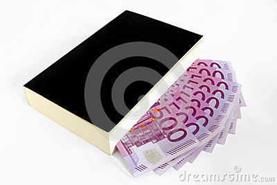 Book and 500 euro s banknotes (paperback)