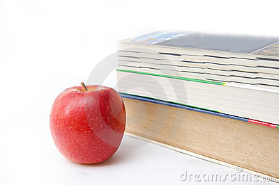 Book and apple on white backgound