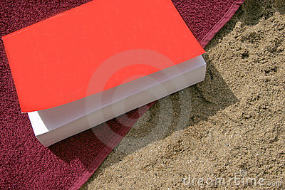 Book on beach with towel