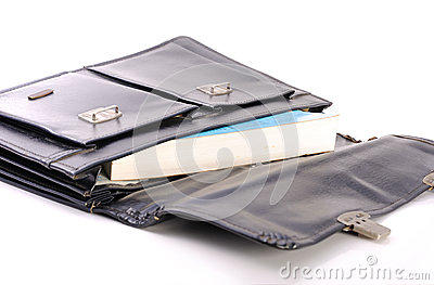 Book in black schoolbag