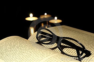 Book candle and glasses