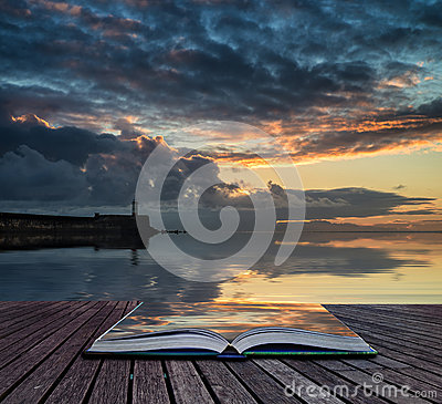 Book concept Beautiful vibrant sunrise sky over calm water ocean