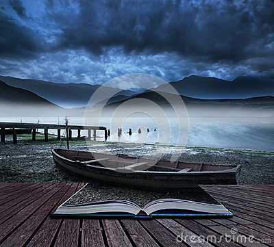 Free Book Concept Old Boat On Lake Of Shore With Misty Lake And Mount Stock Image - 40215201