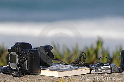 Book,headphones and photo camera