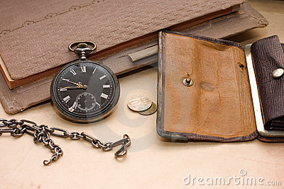 Book, old watch and money