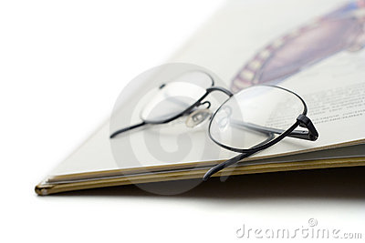 Book and a pair of glasses