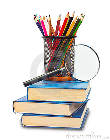 The book, pencils, and magnifying glass
