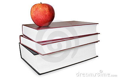 Book stack with an apple isolated on white backgro